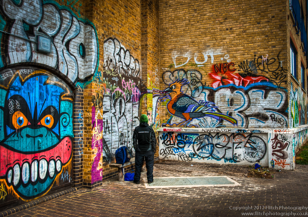 A grafitti artist admires his work