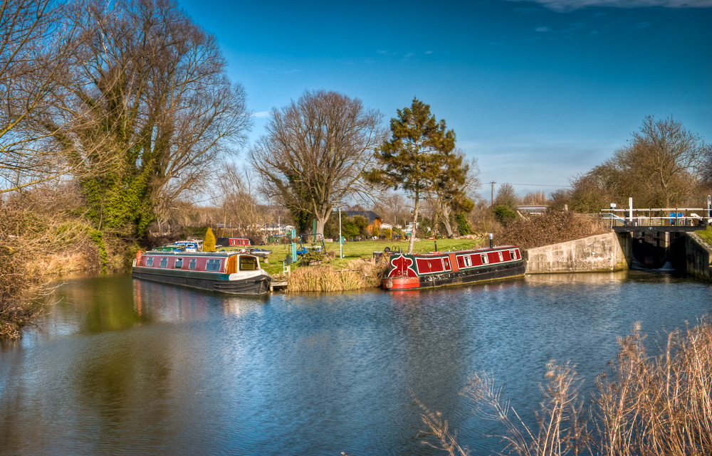 Lock and long boats on the River Stort