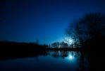 I am lucky enough to live near Hatfield Forest. In the middle of the forest is a large lake where this shot of moonrise was taken.