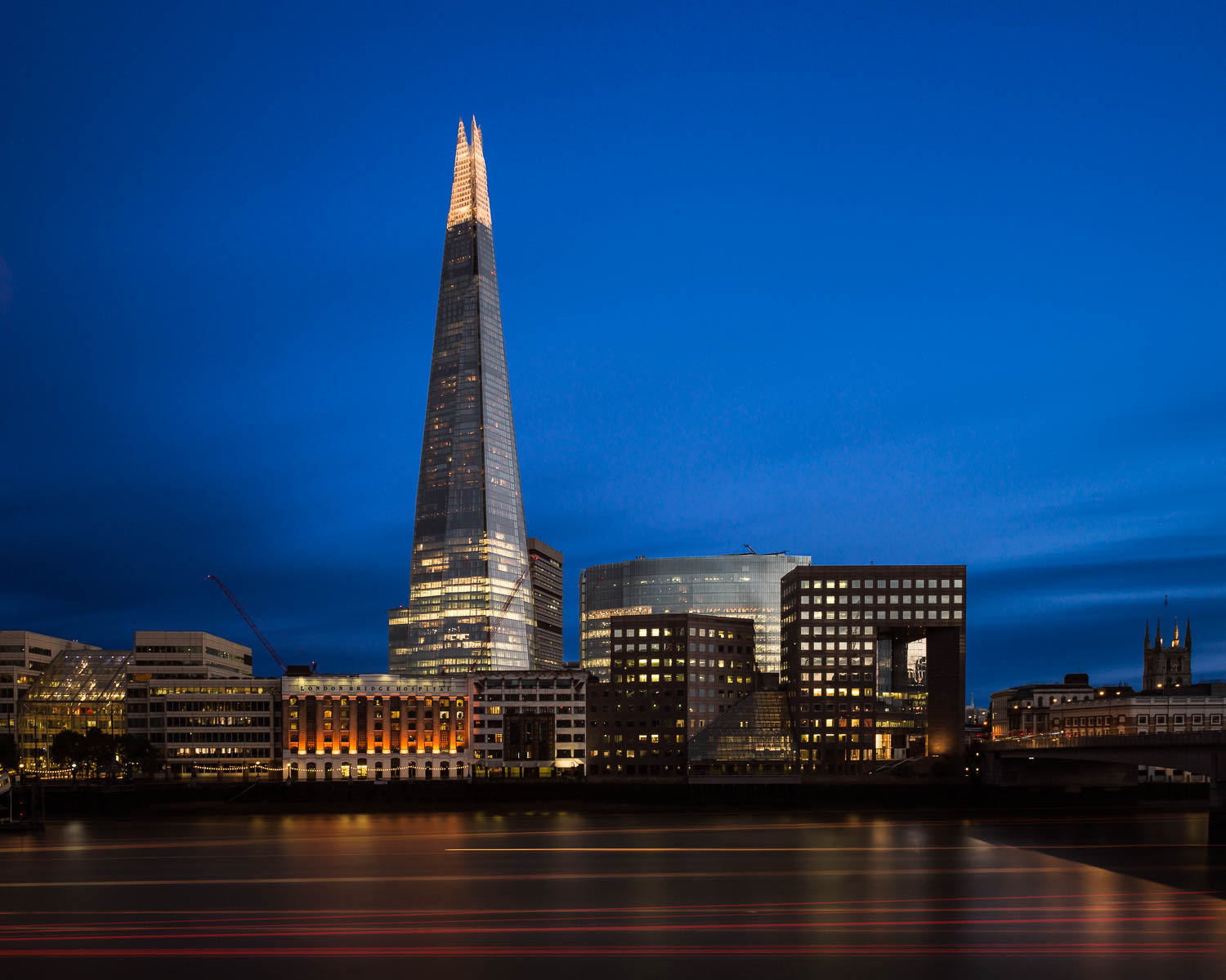 Evening at the Shard - overlooking the Thames River as boats busied themselves